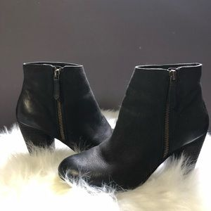 Black booties with gold side zipper
